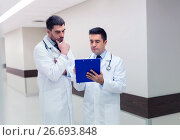 Купить «two male doctors with clipboard at hospital», фото № 26693848, снято 3 декабря 2015 г. (c) Syda Productions / Фотобанк Лори