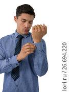 Купить «Businessman buttoning cuff», фото № 26694220, снято 7 апреля 2017 г. (c) Wavebreak Media / Фотобанк Лори