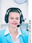 Купить «Female employee having a productive day at call-centre», фото № 26695696, снято 9 июня 2017 г. (c) Яков Филимонов / Фотобанк Лори