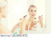 Купить «woman with makeup brush and powder at bathroom», фото № 26699972, снято 13 февраля 2016 г. (c) Syda Productions / Фотобанк Лори