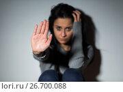 Купить «unhappy crying woman showing defensive gesture», фото № 26700088, снято 20 января 2017 г. (c) Syda Productions / Фотобанк Лори