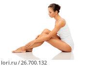 Купить «beautiful woman touching her smooth bare legs», фото № 26700132, снято 9 апреля 2017 г. (c) Syda Productions / Фотобанк Лори
