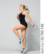 Купить «young woman in black sportswear jumping», фото № 26700148, снято 26 апреля 2017 г. (c) Syda Productions / Фотобанк Лори