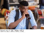 Купить «man drinking draught beer at bar or pub», фото № 26700152, снято 2 мая 2017 г. (c) Syda Productions / Фотобанк Лори