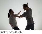 Купить «couple having fight and man choking woman», фото № 26700368, снято 20 января 2017 г. (c) Syda Productions / Фотобанк Лори