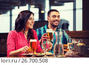 Купить «friends dining and drinking beer at restaurant», фото № 26700508, снято 8 ноября 2015 г. (c) Syda Productions / Фотобанк Лори