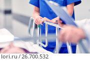 Купить «medics and patient on hospital gurney at emergency», фото № 26700532, снято 3 декабря 2015 г. (c) Syda Productions / Фотобанк Лори