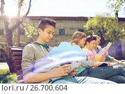 Купить «happy friends with tablet pc computer outdoors», фото № 26700604, снято 21 мая 2016 г. (c) Syda Productions / Фотобанк Лори