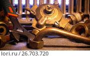 Купить «Details of water and gas fittings of the heater of water and metalwork tool adjustable wrench», видеоролик № 26703720, снято 24 июля 2009 г. (c) Куликов Константин / Фотобанк Лори