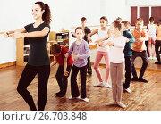 Купить «children studying folk style dance in class», фото № 26703848, снято 12 ноября 2016 г. (c) Яков Филимонов / Фотобанк Лори