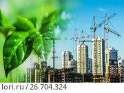 Купить «Строительство новых высотных зданий на фоне зеленого растения», фото № 26704324, снято 11 июня 2019 г. (c) Сергеев Валерий / Фотобанк Лори