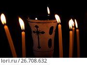 Купить «Лампада в окружении горящих свечей на черном фоне», фото № 26708632, снято 21 июля 2017 г. (c) Irina Opachevsky / Фотобанк Лори
