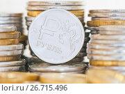 Купить «Монетка в один рубль и стопки рублевых монет разного номинала», фото № 26715496, снято 29 июля 2017 г. (c) Екатерина Овсянникова / Фотобанк Лори