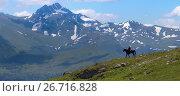 Купить «Пастух на лошади на гребне хребта на фоне вершины Магишо. Западный Кавказ.», фото № 26716828, снято 1 июля 2017 г. (c) Абрамова Ксения / Фотобанк Лори