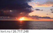 Купить «Dramatic sky during a hurricane and sunset over the ocean», видеоролик № 26717248, снято 30 июля 2017 г. (c) Mikhail Starodubov / Фотобанк Лори