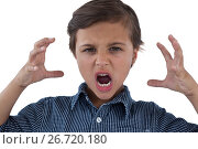Купить «Cute boy shouting against white background», фото № 26720180, снято 24 января 2017 г. (c) Wavebreak Media / Фотобанк Лори