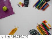 Купить «Various school supplies arranged on white background», фото № 26720740, снято 5 апреля 2017 г. (c) Wavebreak Media / Фотобанк Лори