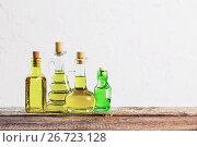 Купить «Olive oil on the wooden table», фото № 26723128, снято 23 мая 2017 г. (c) Майя Крученкова / Фотобанк Лори