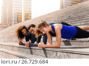Купить «Athletes holding elbow plank outdoors at sunny day», фото № 26729684, снято 8 мая 2017 г. (c) Сергей Новиков / Фотобанк Лори