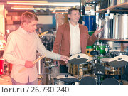 Купить «Boy and father choosing best drum», фото № 26730240, снято 29 марта 2017 г. (c) Яков Филимонов / Фотобанк Лори