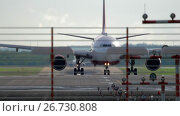 Купить «Airplane braking after landing», видеоролик № 26730808, снято 22 июля 2017 г. (c) Игорь Жоров / Фотобанк Лори