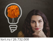 Купить «Woman standing next to light bulb with crumpled paper ball in front of blackboard», фото № 26732008, снято 3 июля 2020 г. (c) Wavebreak Media / Фотобанк Лори