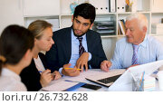 Купить «Office workers are writing financial reports and discussing with mature boss in the office», видеоролик № 26732628, снято 2 июля 2017 г. (c) Яков Филимонов / Фотобанк Лори