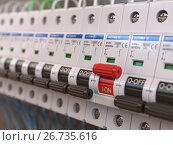 Купить «Switches in fusebox. Many black circuit brakers in a row in position OFF and one red switch in position ON.», фото № 26735616, снято 14 сентября 2018 г. (c) Maksym Yemelyanov / Фотобанк Лори