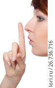 Купить «a girl holds a finger to lips gesture silently», фото № 26736716, снято 10 февраля 2012 г. (c) Tatjana Romanova / Фотобанк Лори