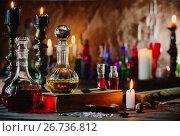 Купить «Magic potion, ancient books and candles», фото № 26736812, снято 4 августа 2017 г. (c) Майя Крученкова / Фотобанк Лори