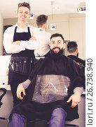Купить «cheerful guy stylist demonstrating final haircut to client at hairdressing salon», фото № 26738940, снято 27 января 2017 г. (c) Яков Филимонов / Фотобанк Лори