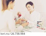 Купить «Woman doing manicure», фото № 26738984, снято 2 февраля 2017 г. (c) Яков Филимонов / Фотобанк Лори