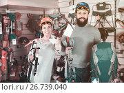 Купить «Couple choosing alpinism equipment in equipment shop», фото № 26739040, снято 24 февраля 2017 г. (c) Яков Филимонов / Фотобанк Лори