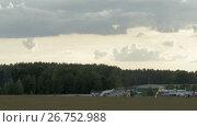 Купить «Skydiver is landing on the grass», видеоролик № 26752988, снято 31 июля 2017 г. (c) Dzmitry Astapkovich / Фотобанк Лори