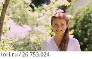 Купить «portrait of happy smiling redhead woman outdoors», видеоролик № 26753024, снято 20 августа 2019 г. (c) Syda Productions / Фотобанк Лори