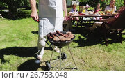 Купить «man cooking meat on barbecue grill at summer party», видеоролик № 26753048, снято 16 июля 2019 г. (c) Syda Productions / Фотобанк Лори