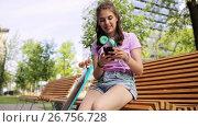 Купить «happy teenage girl with smartphone and longboard», видеоролик № 26756728, снято 10 декабря 2018 г. (c) Syda Productions / Фотобанк Лори