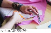 Купить «fashion designer hands cutting cloth with scissors», видеоролик № 26756764, снято 19 августа 2019 г. (c) Syda Productions / Фотобанк Лори