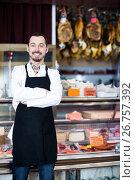 Купить «Seller offering displayed sorts of meat», фото № 26757392, снято 2 января 2017 г. (c) Яков Филимонов / Фотобанк Лори