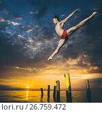 Купить «Ballet dancer in the air», фото № 26759472, снято 6 августа 2017 г. (c) Mark Agnor / Фотобанк Лори