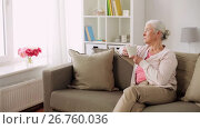 Купить «senior woman with cup of tea or coffee at home», видеоролик № 26760036, снято 7 апреля 2020 г. (c) Syda Productions / Фотобанк Лори