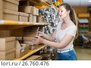Купить «Female searching other gift containers», фото № 26760476, снято 19 апреля 2017 г. (c) Яков Филимонов / Фотобанк Лори