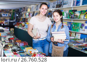 Купить «smiling woman with cheerful girl taking literature books in store with prints», фото № 26760528, снято 9 мая 2017 г. (c) Яков Филимонов / Фотобанк Лори