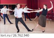 Купить «Young people dancing lindy hop in pairs», фото № 26762940, снято 24 мая 2017 г. (c) Яков Филимонов / Фотобанк Лори