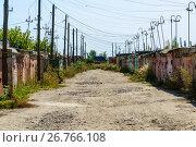 Купить «Brick garages with metal gates of garage cooperative», фото № 26766108, снято 14 августа 2017 г. (c) Володина Ольга / Фотобанк Лори
