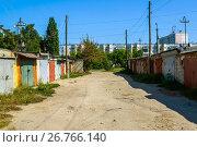 Купить «Brick garages with metal gates of garage cooperative», фото № 26766140, снято 14 августа 2017 г. (c) Володина Ольга / Фотобанк Лори