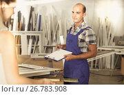 Купить «Craftsman is accepting order for plastic windows from female cli», фото № 26783908, снято 19 июля 2017 г. (c) Яков Филимонов / Фотобанк Лори