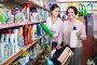 Women picking bottles with detergent, фото № 26783928, снято 23 августа 2017 г. (c) Яков Филимонов / Фотобанк Лори