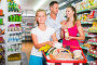 Positive family with teen daughter and purchases in shopping, фото № 26785276, снято 11 июля 2017 г. (c) Яков Филимонов / Фотобанк Лори