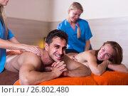 Купить «Couple is relaxing while taking massage», фото № 26802480, снято 18 июля 2017 г. (c) Яков Филимонов / Фотобанк Лори
